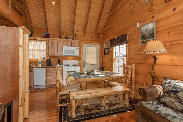 Dining table on the main floor at My Smoky Mountain Hideaway, a 3 bedroom cabin rental located in Pigeon Forge