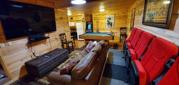 Theater & game room at My Smoky Mountain Hideaway, a 3 bedroom cabin rental located in Pigeon Forge
