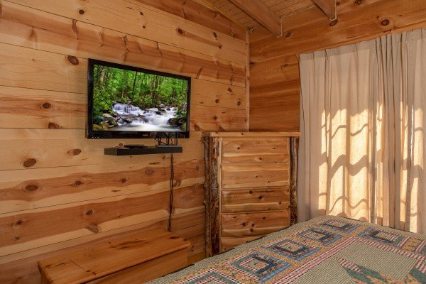 Dresser and TV in a bedroom at My Smoky Mountain Hideaway, a 3 bedroom cabin rental located in Pigeon Forge