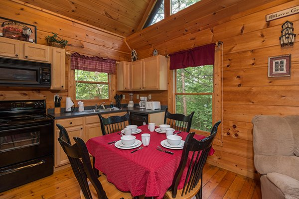 Dining room table with seating for four at Cabin Sweet Cabin, 1-bedroom cabin rental located in Gatlinburg