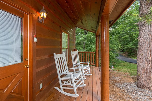 Rocking chairs on the covered porch at the entrance of Cabin Sweet Cabin, 1-bedroom cabin rental located in Gatlinburg