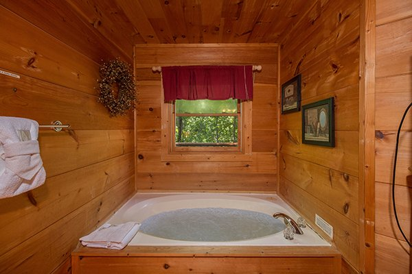 Jacuzzi tub in the bedroom at Cabin Sweet Cabin, 1-bedroom cabin rental located in Gatlinburg