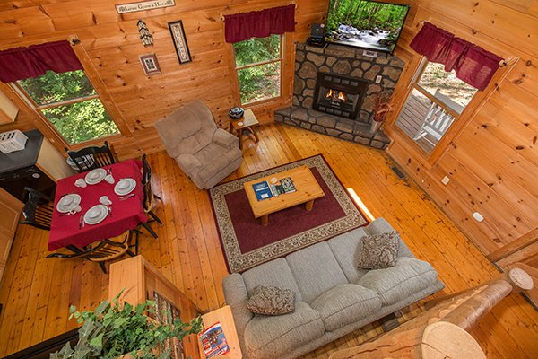 Looking down into the living room from upstairs at Cabin Sweet Cabin, 1-bedroom cabin rental located in Gatlinburg