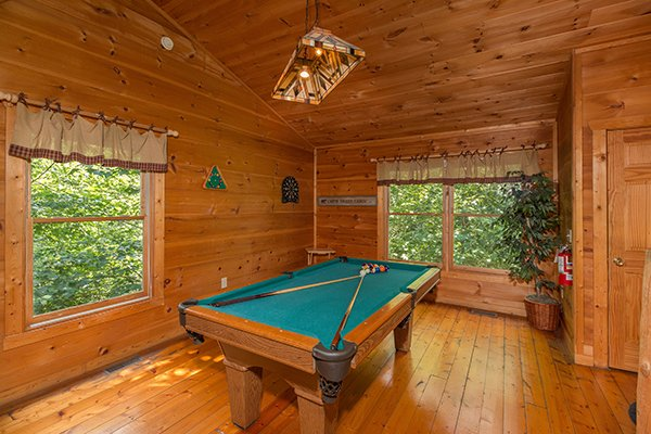 Green felted pool table in the game room at Cabin Sweet Cabin, 1-bedroom cabin rental located in Gatlinburg