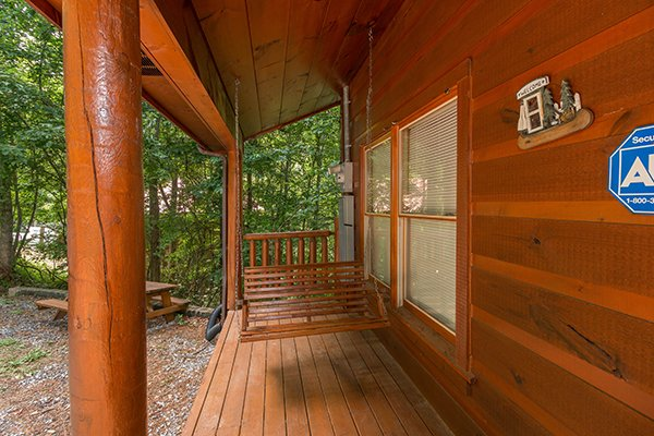 Porch swing on a covered deck at Cabin Sweet Cabin, 1-bedroom cabin rental located in Gatlinburg