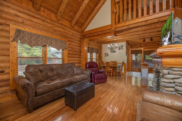 Living room opening up to the dining room at Mountain Escape, a 2 bedroom cabin rental located in Pigeon Forge
