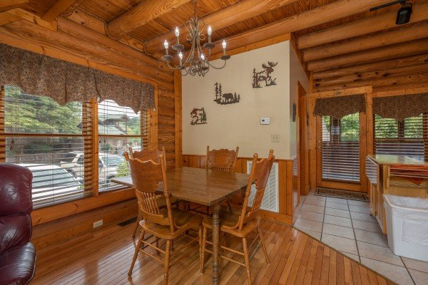 Dining table for four at Mountain Escape, a 2 bedroom cabin rental located in Pigeon Forge