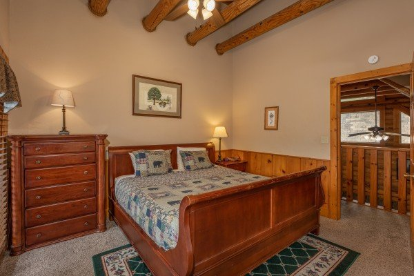 Bedroom with a queen sleigh bed and dresser at Mountain Escape, a 2 bedroom cabin rental located in Pigeon Forge
