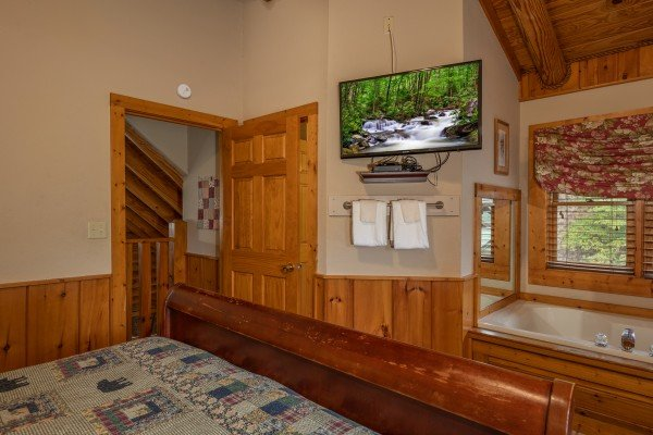 In room jacuzzi and TV at Mountain Escape, a 2 bedroom cabin rental located in Pigeon Forge
