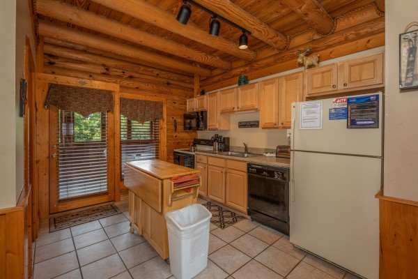 Kitchen with black and white appliances at Mountain Escape, a 2 bedroom cabin rental located in Pigeon Forge