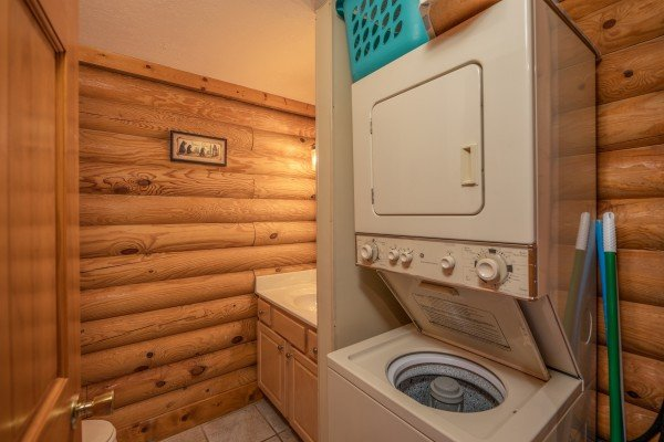 Stacked washer and dry in a bathroom at Mountain Escape, a 2 bedroom cabin rental located in Pigeon Forge