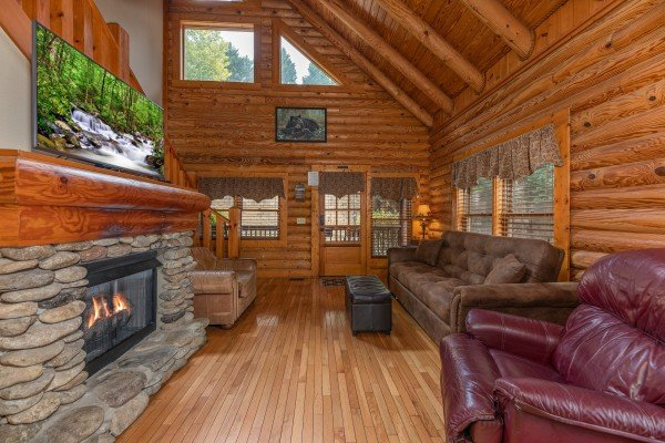Living room with fireplace & TV at Mountain Escape, a 2 bedroom cabin rental located in Pigeon Forge