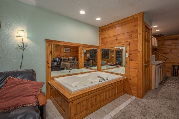 Jacuzzi in the lower living area at Mountain Escape, a 2 bedroom cabin rental located in Pigeon Forge
