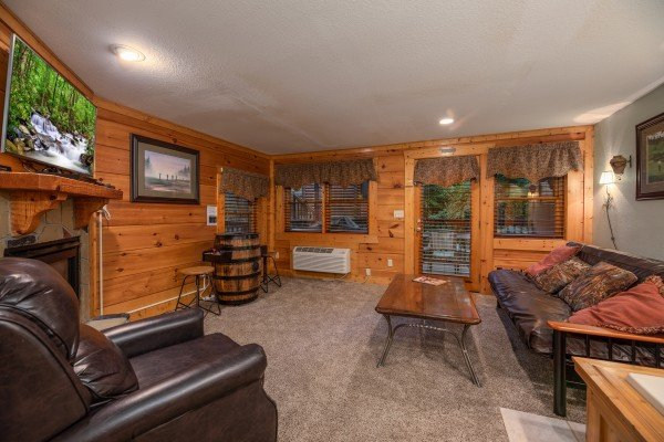 Lower level living room at Mountain Escape, a 2 bedroom cabin rental located in Pigeon Forge