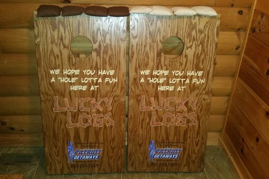 Cornhole bean bag toss game at Lucky Logs, a 3 bedroom cabin rental located in Gatlinburg
