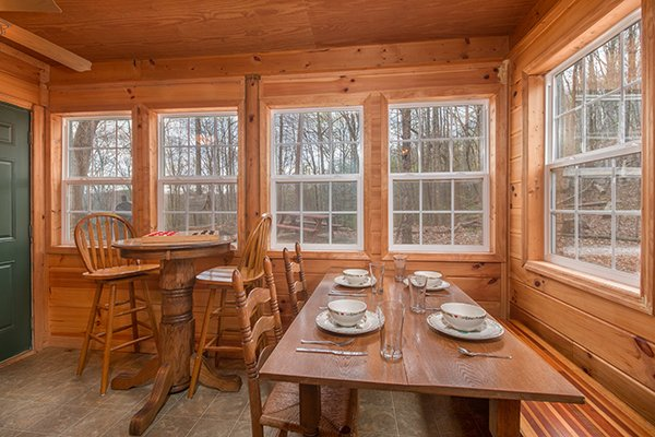 Table for four and high table for two in the dining space at Lucky Logs, a 3 bedroom cabin rental located in Gatlinburg