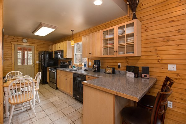 Kitchen with dining space for five people at Lucky Logs, a 3 bedroom cabin rental located in Gatlinburg