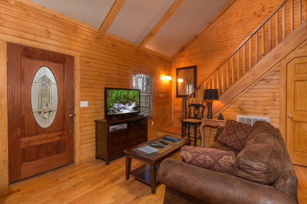 Living room with sofa and TV at Lucky Logs, a 3 bedroom cabin rental located in Gatlinburg
