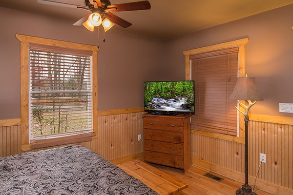 Bedroom with a chest of drawers and TV at Lucky Logs, a 3 bedroom cabin rental located in Gatlinburg