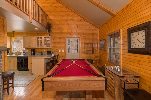 Pool table off the living room at Lucky Logs, a 3 bedroom cabin rental located in Gatlinburg