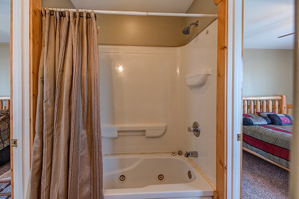 Bathroom with a tub and shower at Lucky Logs, a 3 bedroom cabin rental located in Gatlinburg