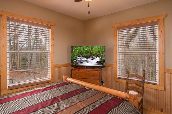 Bedroom with a dresser and TV at Lucky Logs, a 3 bedroom cabin rental located in Gatlinburg