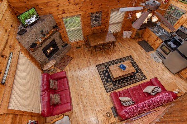 Looking down into the living room at Over the Rainbow, a 3 bedroom cabin rental located in Pigeon Forge