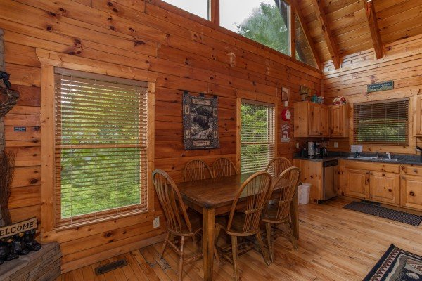 Dining table for six at Over the Rainbow, a 3 bedroom cabin rental located in Pigeon Forge