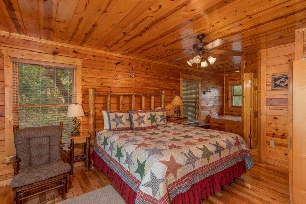 Bedroom with a king bed at Over the Rainbow, a 3 bedroom cabin rental located in Pigeon Forge