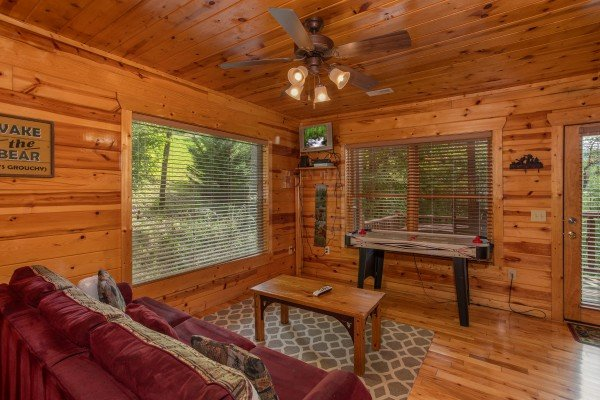 Sleeper sofa and foosball on the first floor at Over the Rainbow, a 3 bedroom cabin rental located in Pigeon Forge