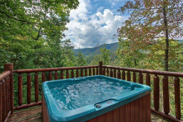 Hot tub on a deck at Over the Rainbow, a 3 bedroom cabin rental located in Pigeon Forge