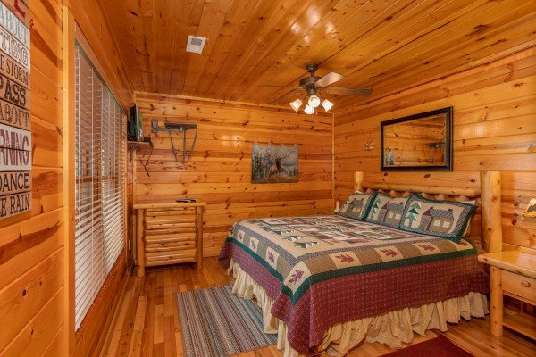 King bedroom on the first floor at Over the Rainbow, a 3 bedroom cabin rental located in Pigeon Forge