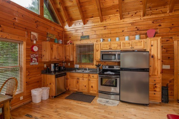 Kitchen with stainless appliances at Over the Rainbow, a 3 bedroom cabin rental located in Pigeon Forge
