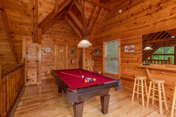 Pool table in the loft game room at Over the Rainbow, a 3 bedroom cabin rental located in Pigeon Forge