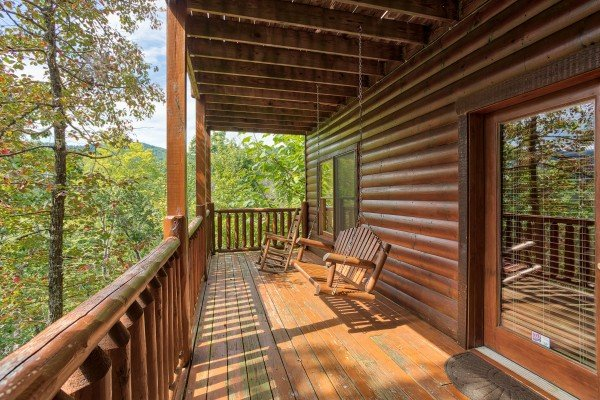Porch swing on the first floor deck at Over the Rainbow, a 3 bedroom cabin rental located in Pigeon Forge