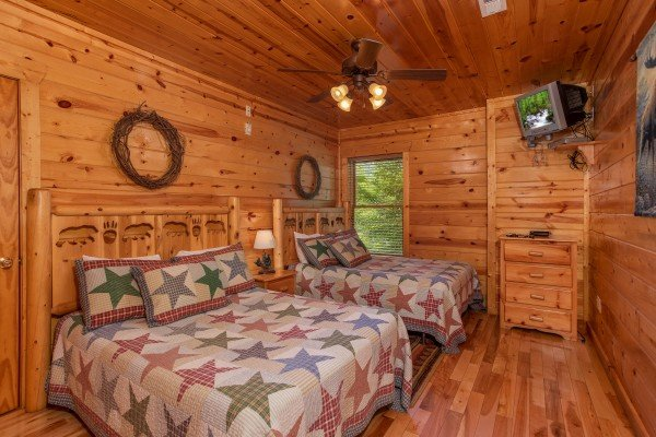 Two full beds in a first floor bedroom at Over the Rainbow, a 3 bedroom cabin rental located in Pigeon Forge