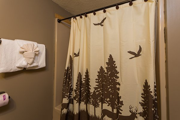 Bathroom with tub and shower at Soaring Heights, a 3 bedroom cabin rental located in Gatlinburg