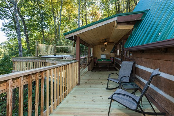 Deck with covered areas and hot tub area at Soaring Heights, a 3 bedroom cabin rental located in Gatlinburg