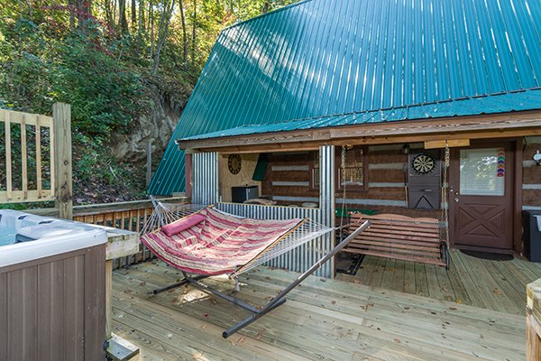 Hammock near the hot tub on the deck at Soaring Heights, a 3 bedroom cabin rental located in Gatlinburg