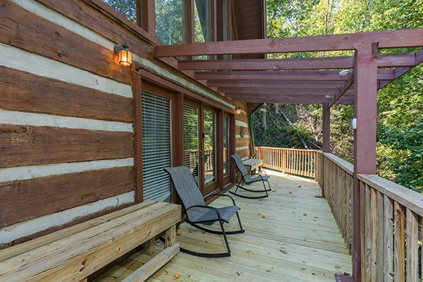 Rocking chairs on the deck at Soaring Heights, a 3 bedroom cabin rental located in Gatlinburg