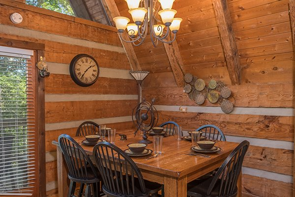 Dining table with seating for six at Soaring Heights, a 3 bedroom cabin rental located in Gatlinburg