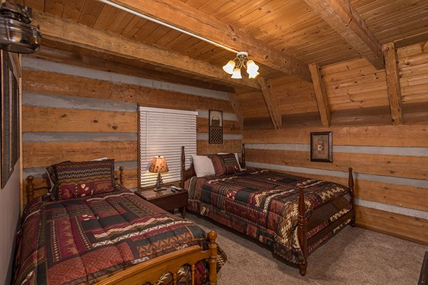 Bedroom with two beds at Soaring Heights, a 3 bedroom cabin rental located in Gatlinburg