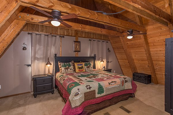King bed in a loft room at Soaring Heights, a 3 bedroom cabin rental located in Gatlinburg