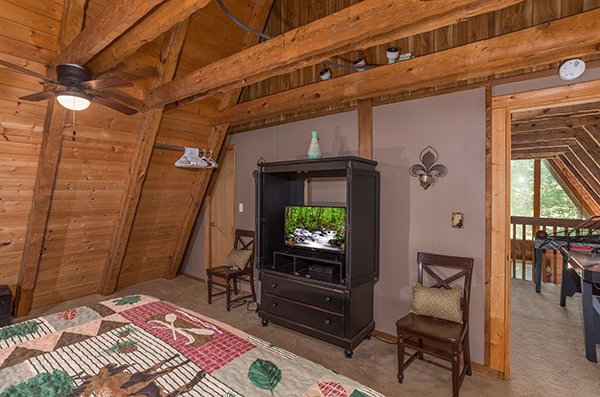 TV in an entertainment center console at Soaring Heights, a 3 bedroom cabin rental located in Gatlinburg