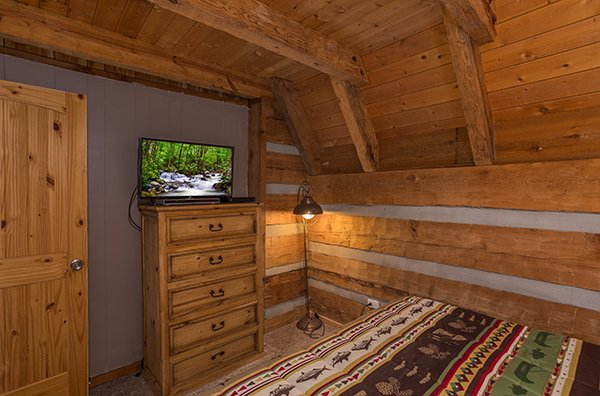 Dresser and TV in the loft bedroom at Soaring Heights, a 3 bedroom cabin rental located in Gatlinburg