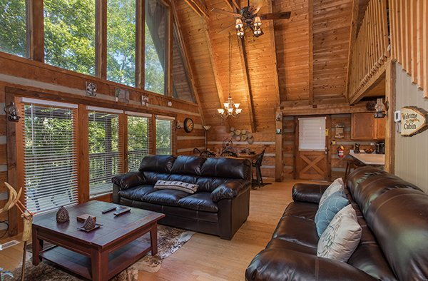 Sofas and dining space on the main floor at Soaring Heights, a 3 bedroom cabin rental located in Gatlinburg