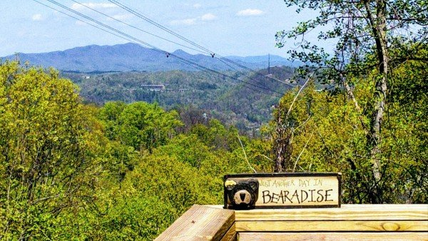 Custom sign and the view at Soaring Heights, a 3 bedroom cabin rental located in Gatlinburg