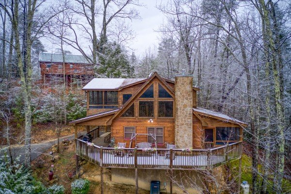 Looking back at Alpine Romance, a 2 bedroom cabin rental located in Pigeon Forge with a dusting of snow