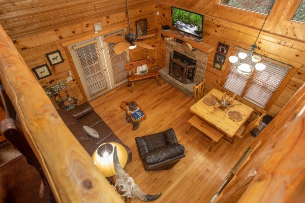 Looking down on the main floor from the loft at Alpine Romance, a 2 bedroom cabin rental located in Pigeon Forge