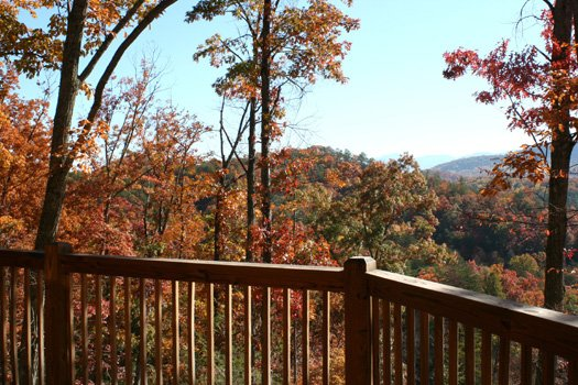 deck banister overlooking fall foilage from alpine romance a 2 bedroom cabin rental located in pigeon forge